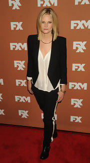 Joelle Carter chose a structured black blazer to top off her black-and-white red carpet look.
