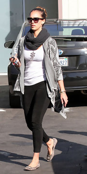 Jessica Alba was cool and casual in a print sweater and suede embellished flats.