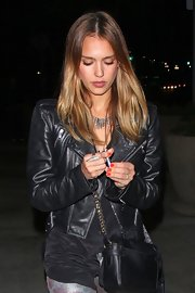 Jessica Alba's black chain strap bag fit right in with her black leather motorcycle jacket.