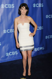 Cobie Smulders teamed her flirty white strapless dress with black suede pumps.