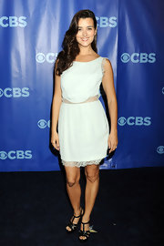 Cote wears a white lace frock to the CBS Upfront event. She pairs the look with black t-bar platforms.