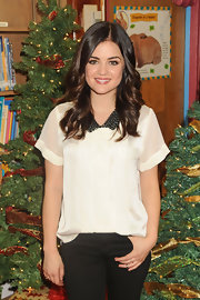 Lucy looked so cute in this white blosue with a funky jeweled collar at the holiday kick-off.