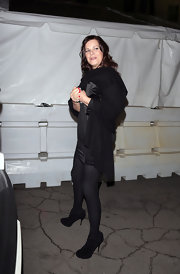 Marcia Gay Harden was seen at the Pre-Oscar Party wearing a sheer mini dress topped with a shawl, some black tights, and a pair of suede ankle-boots.