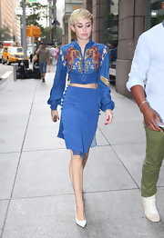 Miley opted for a stylish blue skirt to pair with her blue bomber.