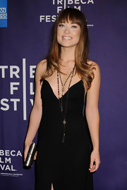 Olivia Wilde added shien to her sultry LBD with a petite silver clutch.