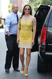 Paula Patton wore this nude silk tulle cocktail dress with canary yellow lace while out in NYC.