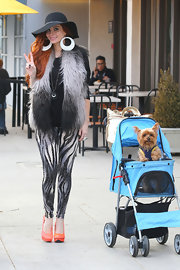 What's crazier here? Phoebe's zebra-print sequined pants? Or the fact that her dog's in a stroller? Kidding! (Well, sort of...)