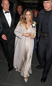 Sarah Jessica Parker's floor-sweeping evening coat lent drama to her classic look.