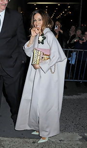 Sarah Jessica Parker's alligator clutch added color to her evening theater ensemble.