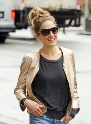 Sarah Jessica Parker simply swept her curls up into a casual looped ponytail before heading out in Soho.