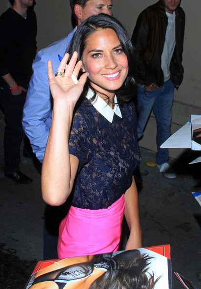 Actress and model Olivia Munn seen greeting fans and signing autographs while making an appearance on a TV show in Hollywood