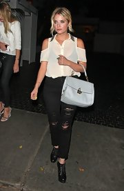 Ashley Benson topped off her edgy nighttime look with a baby blue bowler bag.