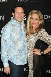Adrienne Maloof complemented her leopard-print dress with a gorgeous turquoise and gold cuff bracelet during a party in Vegas.