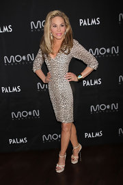 Adrienne Maloof stepped out to a party at the Palms Resort and Casino in Las Vegas wearing a pair of ivory T-strap platform sandals.
