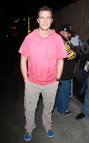 Bear Grylls' neutral cargo pants paired well with his colorful top and footwear.