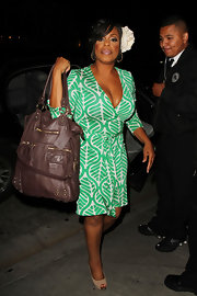 """Dancing with the Stars"" contestant Niecy Nash showed off her printed wrap dress while attending a party in LA. She carried a large shoulder bag to complete her look."
