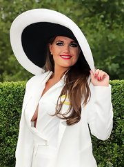 Rosie Calder opted for a super wide black and white hat for the opening day of the Royal Ascot.