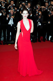 Kristen Stewart got sassy with her posing on the red carpet at Cannes in this red gown with lace cutouts.