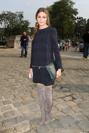 Olivia Palermo was '60s-chic at the Carven fashion show in gray thigh-high boots and a plaid mini dress.
