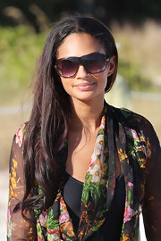 Alesha Dixon hit the beach in a pair of oversize shield sunglasses with black frames.