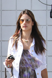 Alessandra Ambrosio topped off her carefree bohemian look with a pair of retro-style aviator shades.