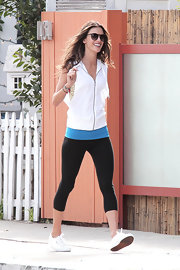 A sleeveless zip-up vest was both sporty and stylish on model Alessandra Ambrosio who posed for Victoria's Secret during a photo shoot in California.
