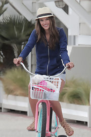 A cool straw had with polka dot trim topped off Alessandra Ambrosio's casual and playful look on the set of a Victoria's Secret photo shoot.