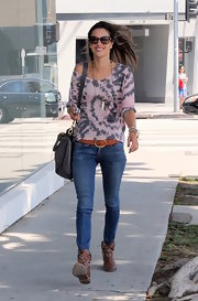 Alessandra Ambrosio topped off her boho-style look with a pair of cowboy ankle booties.