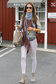Alessandra Ambrosio kept her look boho cool with a blue patterned scarf with red fringe.