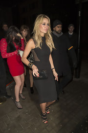 Alex Curran wore a LBD with mesh cutouts while out in London.