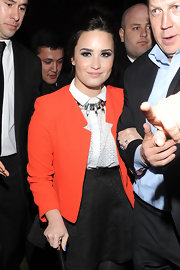 Demi Lovato looked playful and girlie in a butterfly jacquard full skirt and orange blazer.
