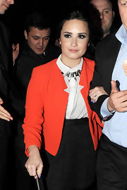 Demi Lovato added a bit of a rocker edge to her look with a box spike collar while out after the Brit Awards.