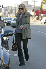 Ali Larter brought a touch of the '70s into her street style with a pair of extra long dark denim flares.