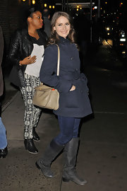 Alison Brie covered up with a stylish charcoal wool coat as she left 'The Late Show with David Letterman.'