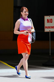 Alyson Hannigan chose this bold and colorful look while out in NYC when she opted for a violet and orange day dress.