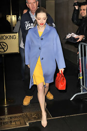 We loved this Jackie O lilac wool coat Amanda was spotted wearing in NYC.