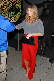 Amber Lancaster's silky dove gray blouse contrasted beautifully against a fiery red skirt.