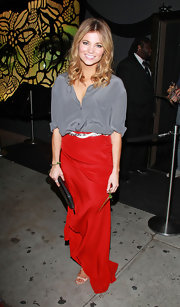 Amber Lancaster dressed up her silky gray top with a flowing red skirt.