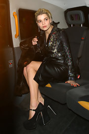Pixie Geldof donned larger than life black suede mary jane platforms during London Fashion Week.