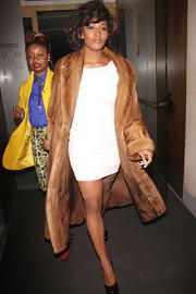 Tocara Jones made quite the entrance in a tiny white cocktail dress and a long fur coat.