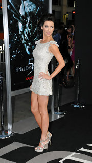Jacqueline showed off her muscular figure in a silvery cocktail dress with a ruffled sleeve for the 'Final Destination 5' movie premiere.