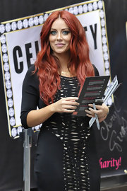 Aubrey O'Day let her luxurious red locks cascade over her shoulders while promoting her new album in NYC.