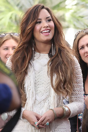 To get long, luxurious locks like Demi Lovato, it's important to get regular trims and to use a good conditioner like Carol's Daughter Monoi Repairing Conditioner  after shampooing. Also, avoiding heat styling as much as possible and using products that contain little or no alcohol will help keep hair from drying out and becoming brittle.