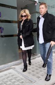 Demi Lovato chose a black zip-up raincoat for her outerwear while out in London.