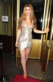 Amy made a grand exit in a sparkly silver wrap dress with a provocative neckline.