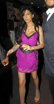 Amy hit the town with her boyfriend wearing a strapless, two-toned cocktail dress.