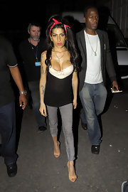 Amy partied at a club in London in a tank top and acid-washed, cropped skinny jeans.