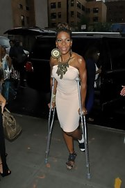 Crutches notwithstanding, Andrea Kelly looked oh-so-chic in her baby-pink halter dress.
