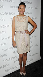 Aisha Tyler topped off her lacy frock with cream platform pumps.