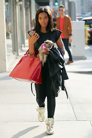 Angela Simmons was out and about in Beverly Hills wearing a pair of metallic silver high tops.
